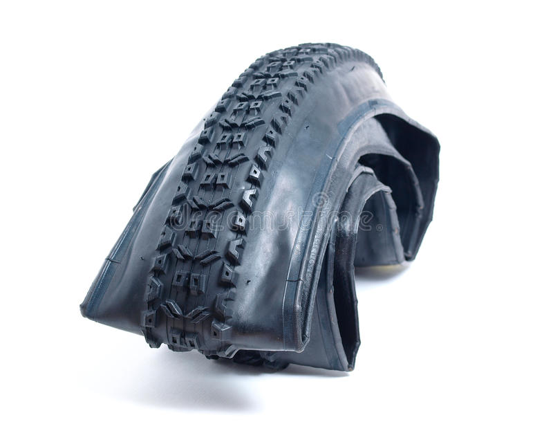 Mountain bike tire deflated. On white background royalty free stock image