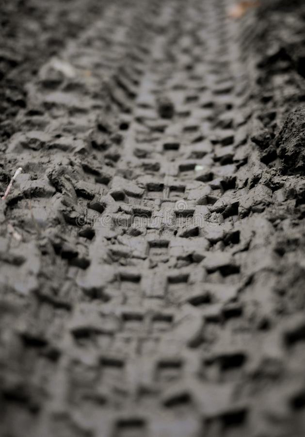 Mountain bike tire tracks. Tracks from the tires of a mountain bike in the soft moist dark dirt stock images