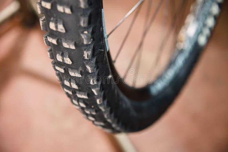 Mountain bike tire tread closeup at home workshop stock image