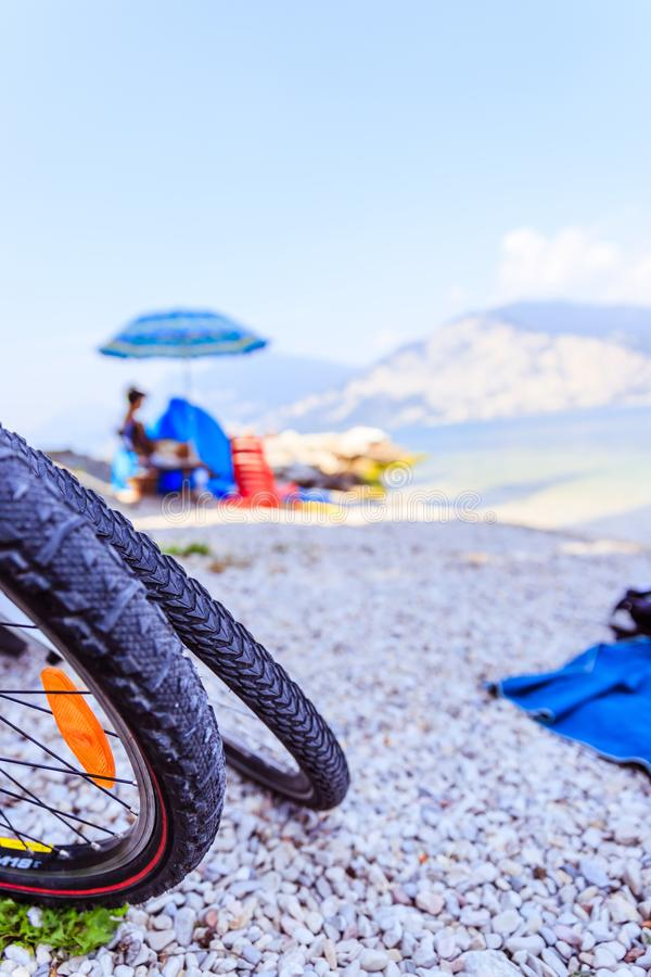 Mountain bike tyres on the beach, copy space. Bicycle beach bike tyre trip tour sports adventure free time holidays sand stones coast sea accessories sky relax royalty free stock images