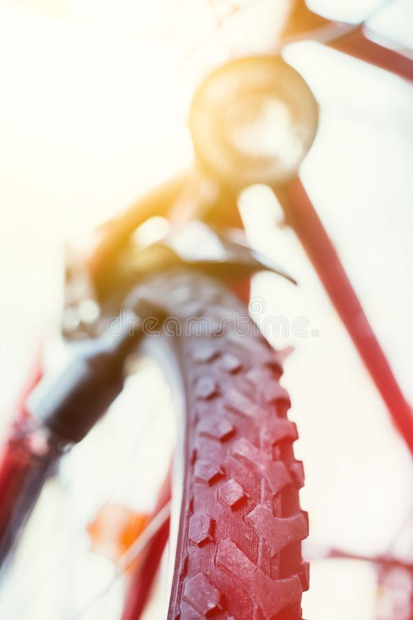 Mountain bike tyres outside, summer day, city mobility. Close up picture of a mountain bike tyre, summer day bicycle trip city mobility tour sports adventure royalty free stock photo