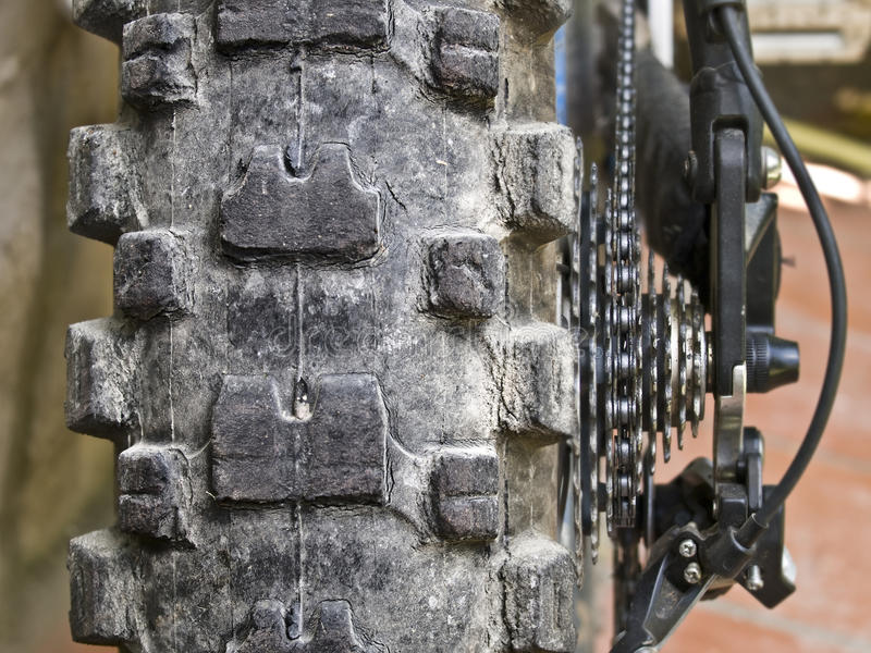 Mountain Bike Wheel. Detail of the rear wheel of a mountain bike and the drive system, with the cassette and the chain royalty free stock images