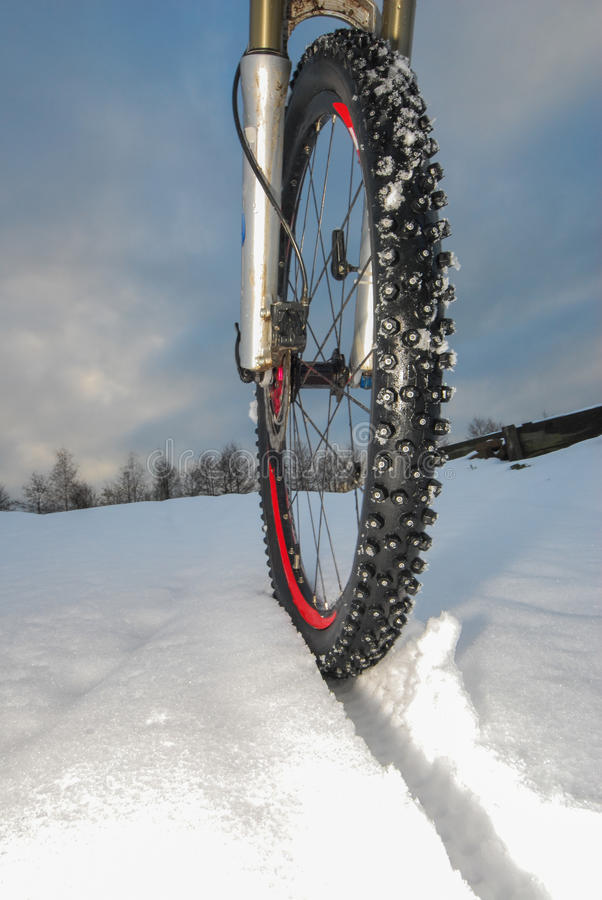 Mountain bike winter tire. With spikes prevents slipping and sliding stock photography