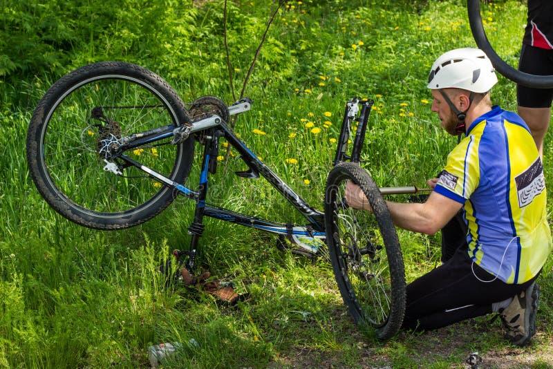 Mountain bike. Young people are repairing tire mountain bike stock photo