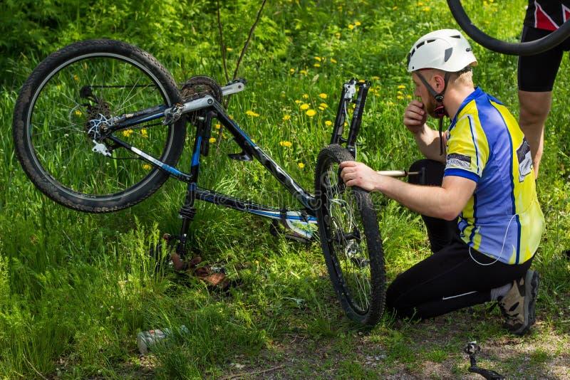 Mountain bike. Young people are repairing tire mountain bike stock photos