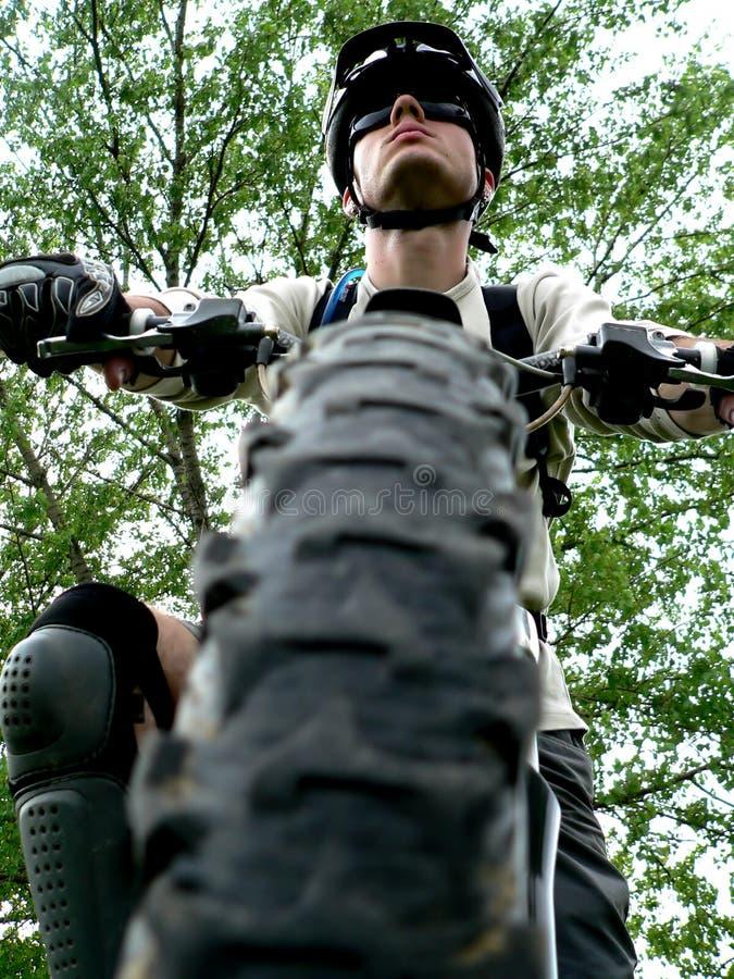 Mountain biker. Mountain bike tire and the biker boy stock photos
