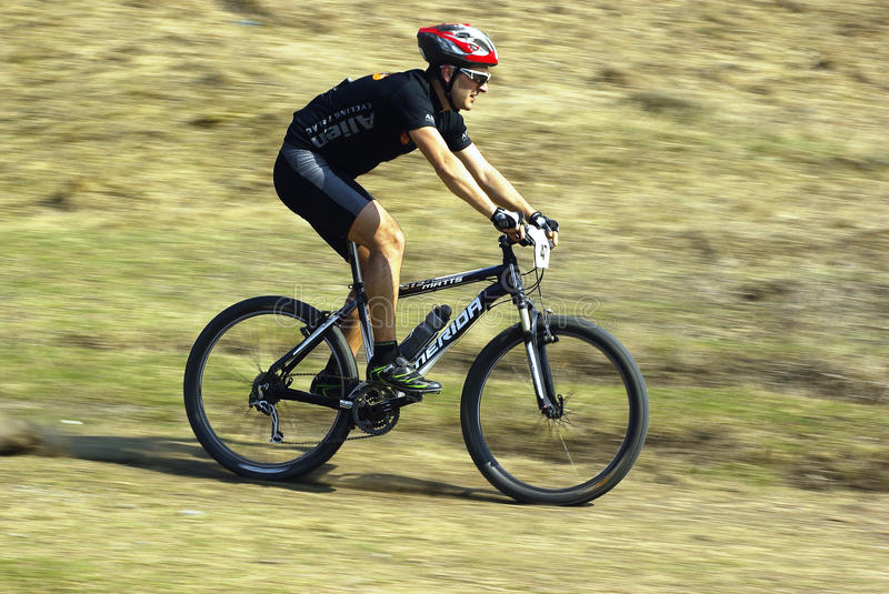 Download Mountain Biker At A Competition Editorial Stock Image - Image: 24018299