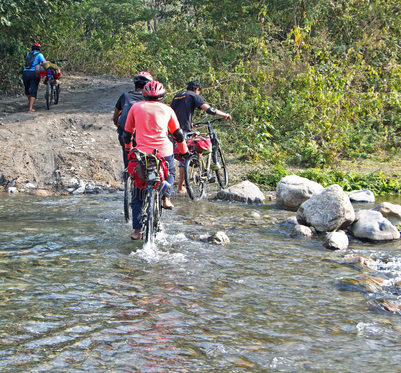 Mountain biker and creek royalty free stock photo