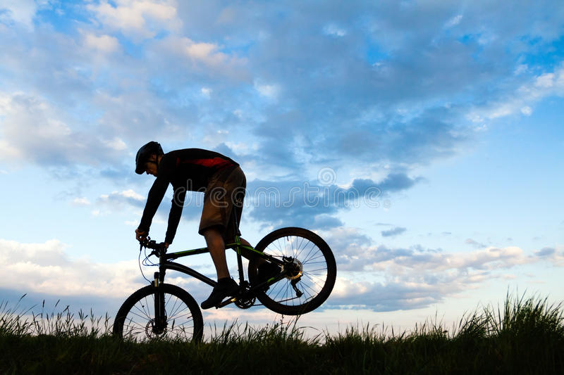 download mountain biker cycling silhouette over blue sky stock image image 94816173