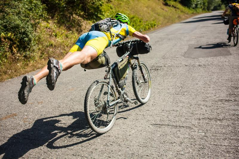 Mountain biker is having fun on the descent.  stock photo