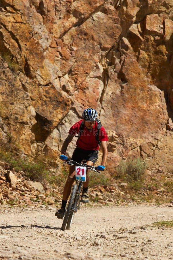 Mountain biker racing stock photo