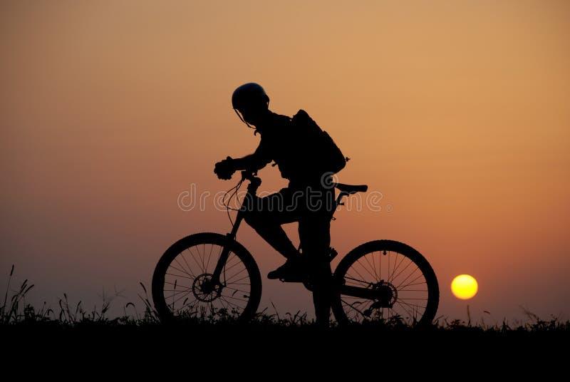 Mountain biker silhouette stock photos