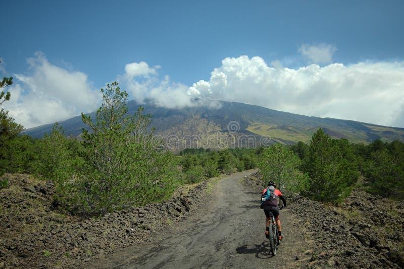 Mountain biker on slope of Etna Volcano royalty free stock photos