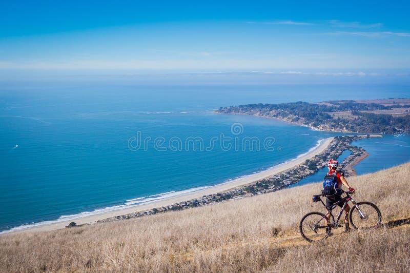 Mountain biker on trail. stock photos