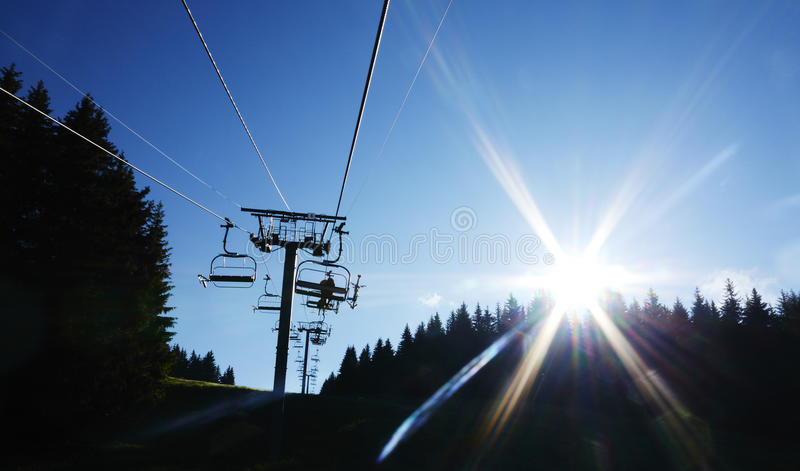 Mountain bikers on Alps chair lift. Morzine France royalty free stock photos