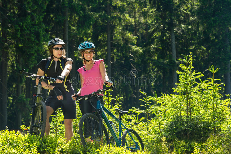 Mountain bikers resting in forest stock photos