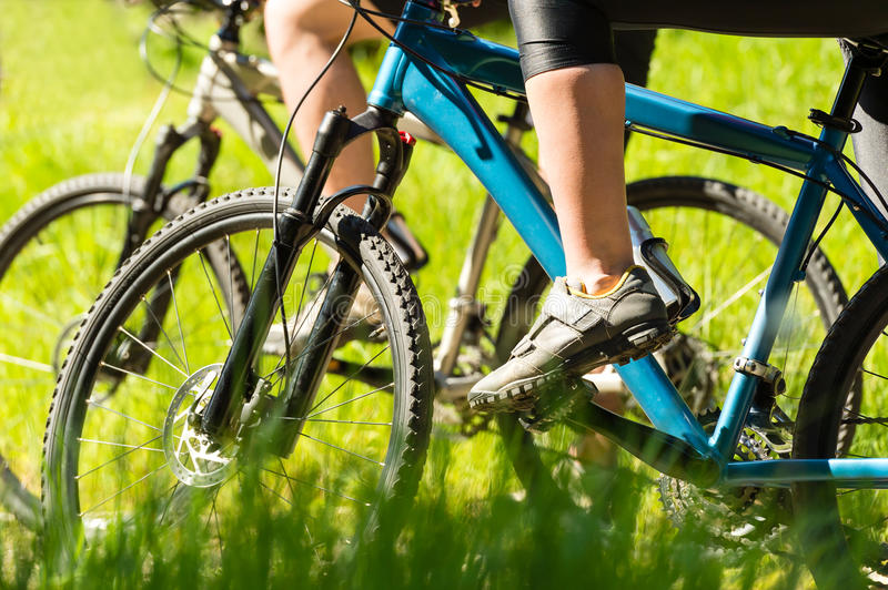 Mountain bikers wearing cycling shoes closeup stock images