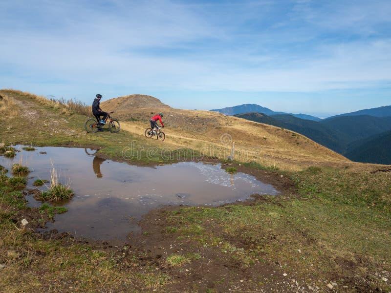 Mountain biking in Baiu Mountains, Romania. Azuga/Romania - September 28 2019: Mountain bikers in Baiu Mountains. The Baiu Mountains are located in central royalty free stock photo