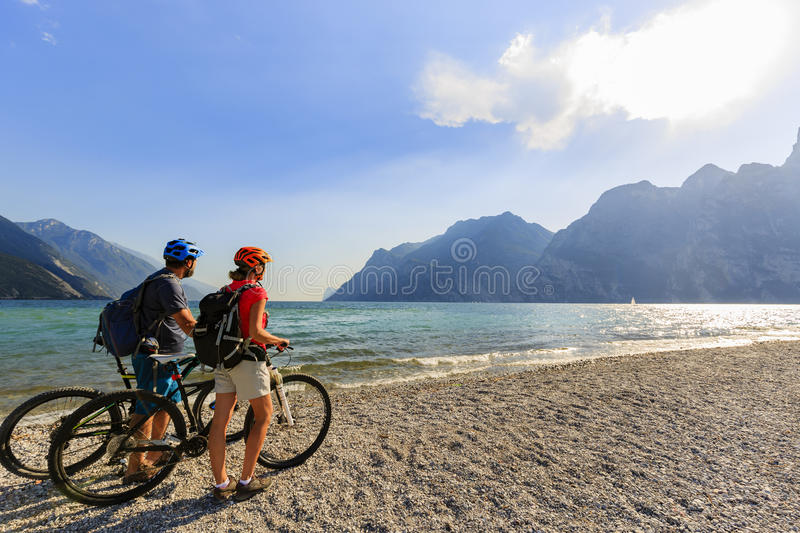 Mountain biking couple on Lake Garda. royalty free stock photo