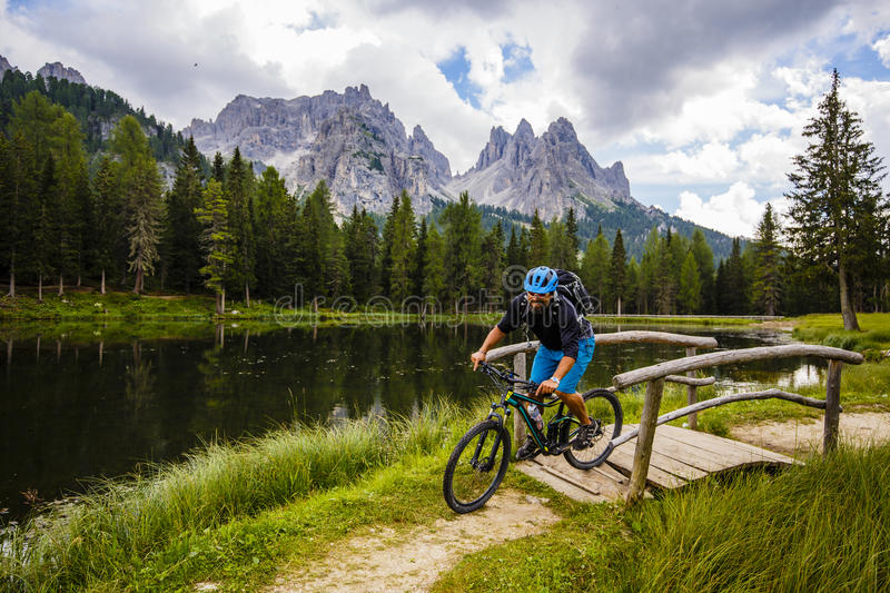 Mountain biking in the Dolomites, Misurina, Italy. Tre Cime di L royalty free stock photography