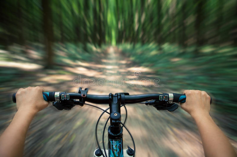 Mountain biking down hill descending fast stock photography