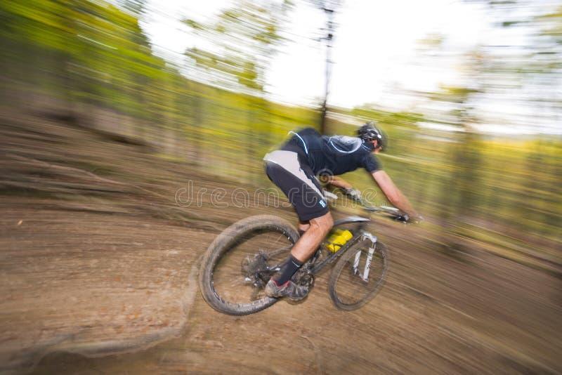 Mountain biking downhill extreme stock photography