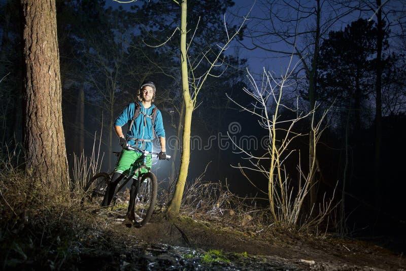 Mountain biking at dusk royalty free stock photos