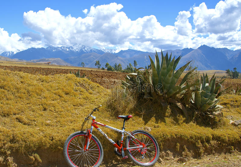 Mountain biking in Sacred Valley, Peru. Andean highlands landscape with mountain bike. Near Maras, Moray. Sacred Valley, Peru stock photos