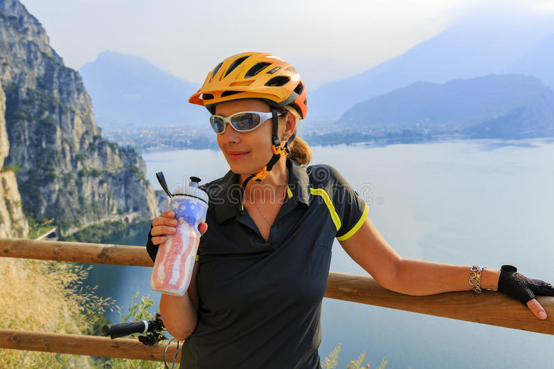 Mountain biking woman drinking water. stock photo