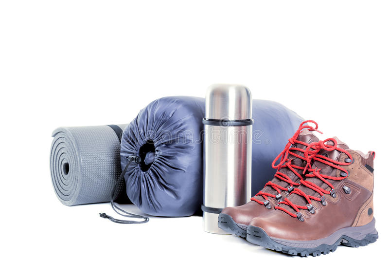 mountain boots thermo flask sleeping bag and mat on white background stock photo