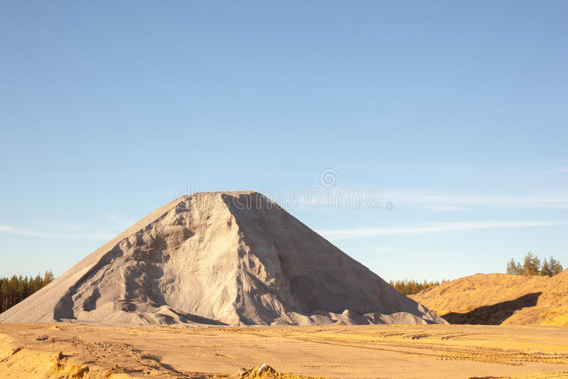 Mountain building rubble. Great mountain of sand stock photography