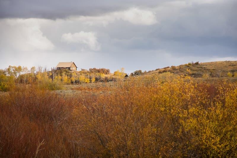 Cabin In Fall Landscape stock photo