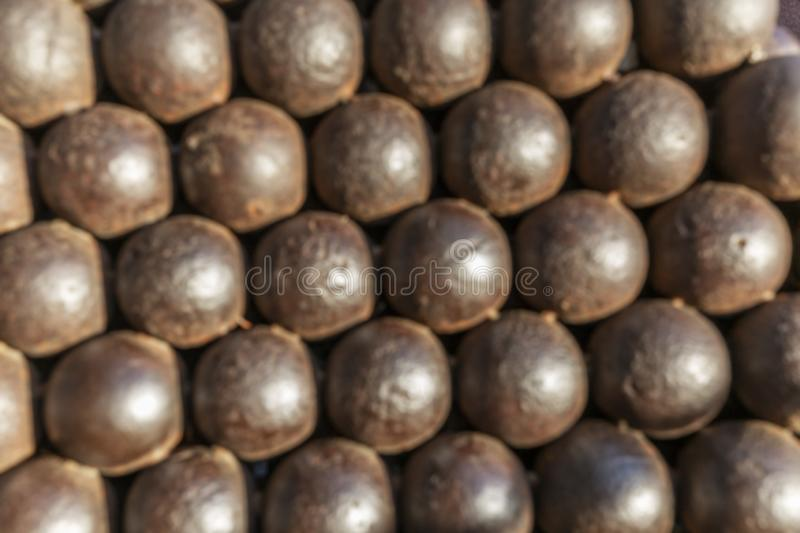 Mountain of cannonballs. Blurred. Background. Space for text stock photo