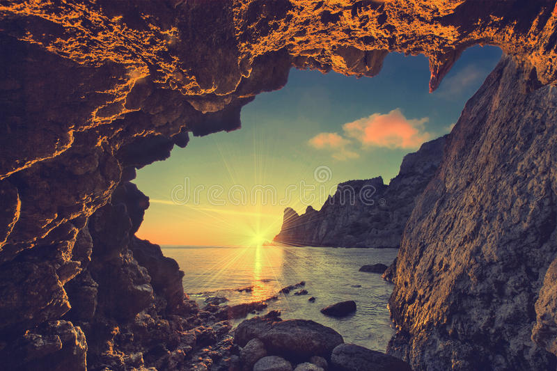 From the mountain cave V. Vintage sea sunset from the mountain cave royalty free stock photography