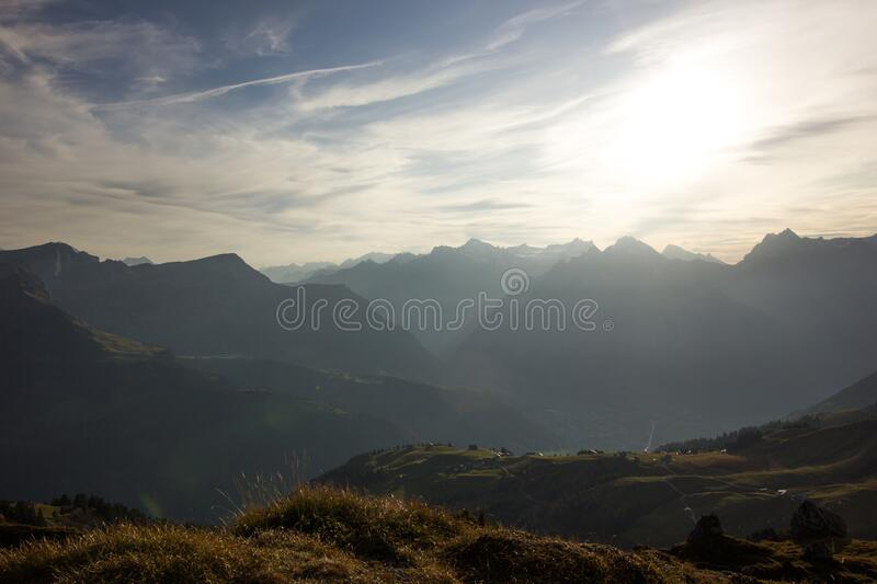 Mountain chain on a misty and sunny evening. Mountain chain on a misty sunny evening stock image