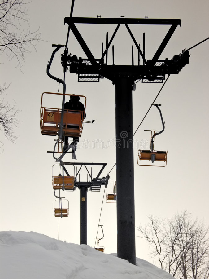 Free Mountain Chairlift: The Last Skier Stock Image - 298901
