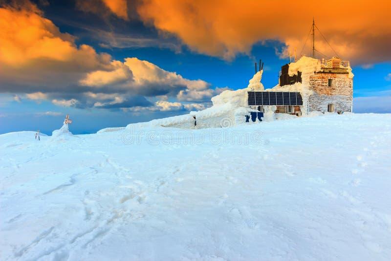 Mountain chalet and sunset,Bucegi mountains,Carpathians,Transylvania,Romania,Europe. Mountain shelter with solar panel and majestic sunrise,Bucegi mountains royalty free stock images
