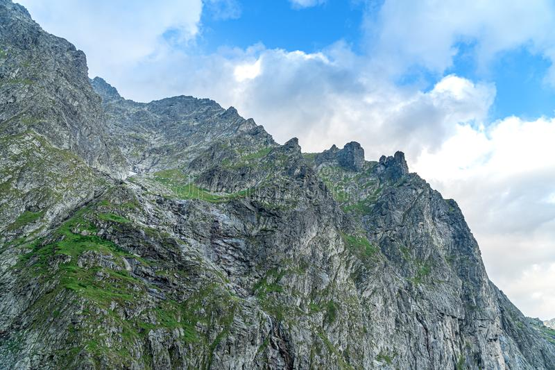 Mountain cliff against the sky stock photography