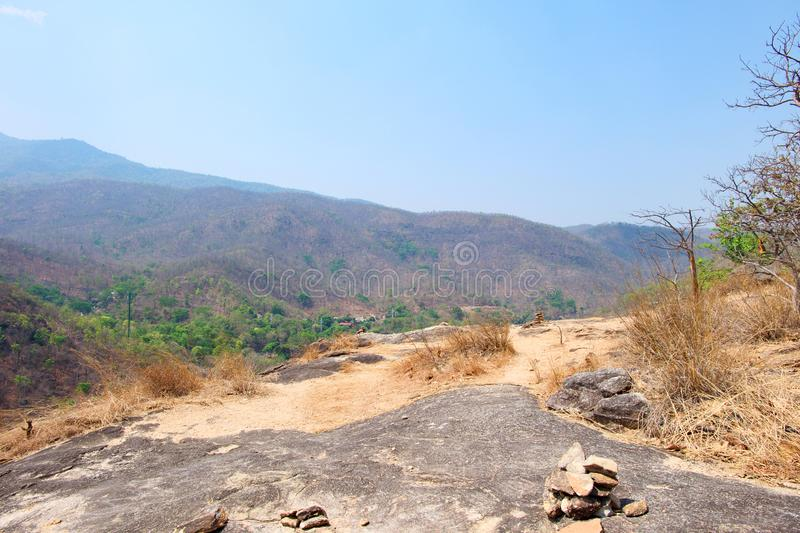 Mountain or cliff have sand and rock with blue sky at Op Luang National Park, Hot, Chiang Mai, Thailand. Hot weather and arid.  stock images