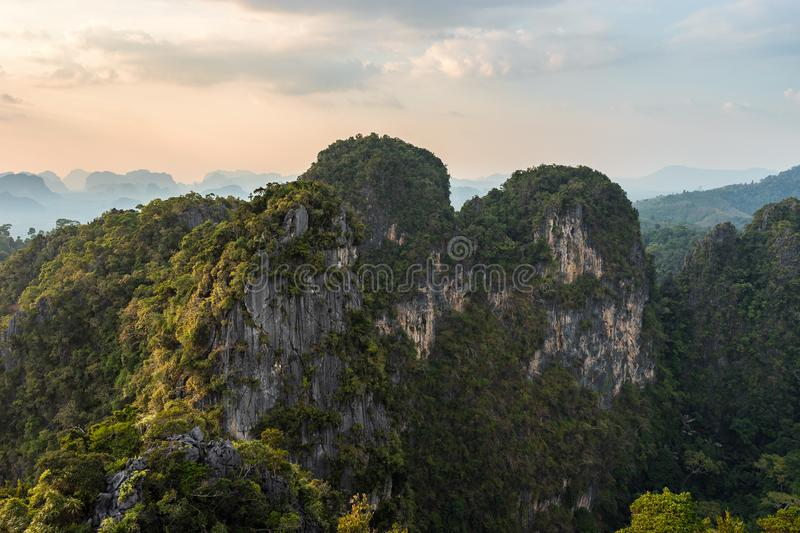 Mountain and cliffs in Thailand is covered with tropical greenery stock photo