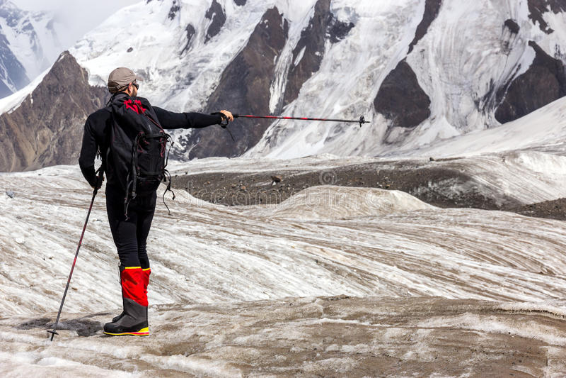 Mountain Climber Pointing Direction stock photos