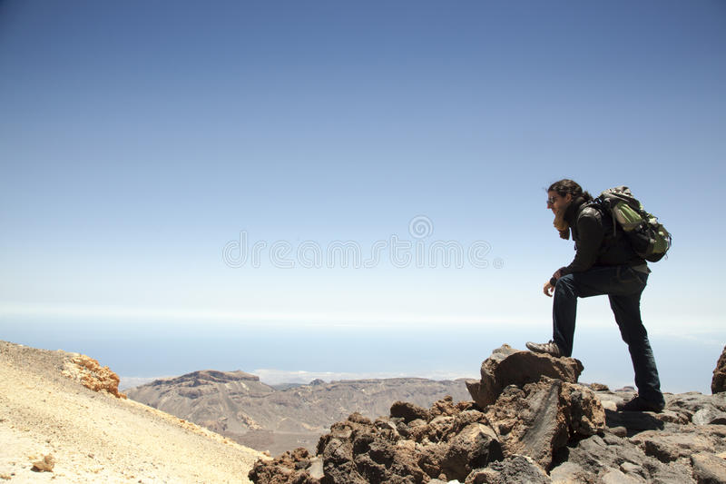 Mountain climber on the top of Teide. Adventurous spanish mountain climber on the top of Teide royalty free stock images