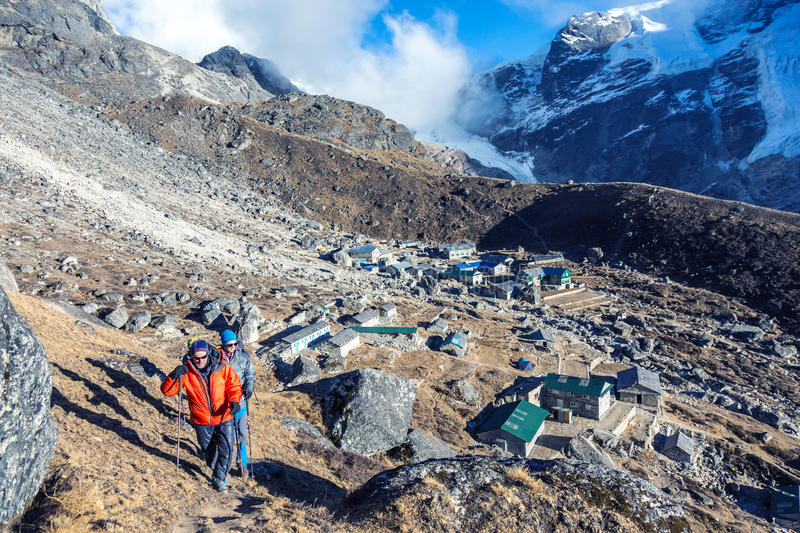 Mountain Climbers doing high Altitude acclimatisation Training. View of Mountain Settlement in Nepal and group of Himalaya Climbers doing acclimatisation royalty free stock photo