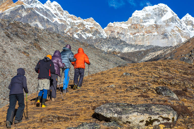 Mountain Climbers doing high Altitude acclimatisation Training. View of Mountain Settlement in Nepal and group of Himalaya Climbers doing acclimatisation royalty free stock photos