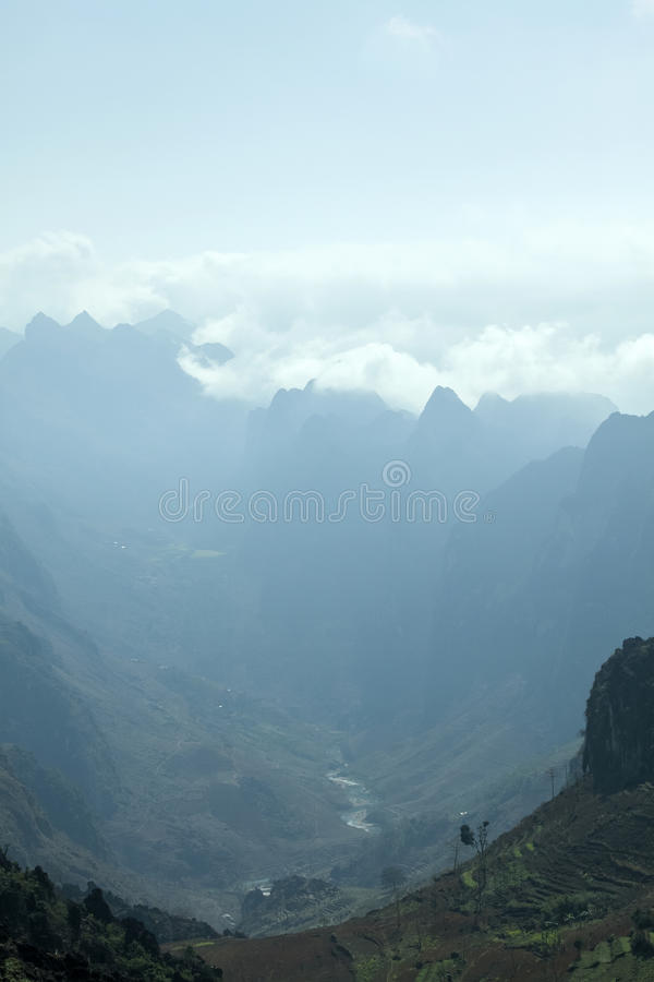 Mountain and cloud in Van stone. Van Stone Plateau (natural or painted Van) is a rocky plateau spread over four districts of Quan Ba, Yen Minh, Van, Meo Vac royalty free stock photo
