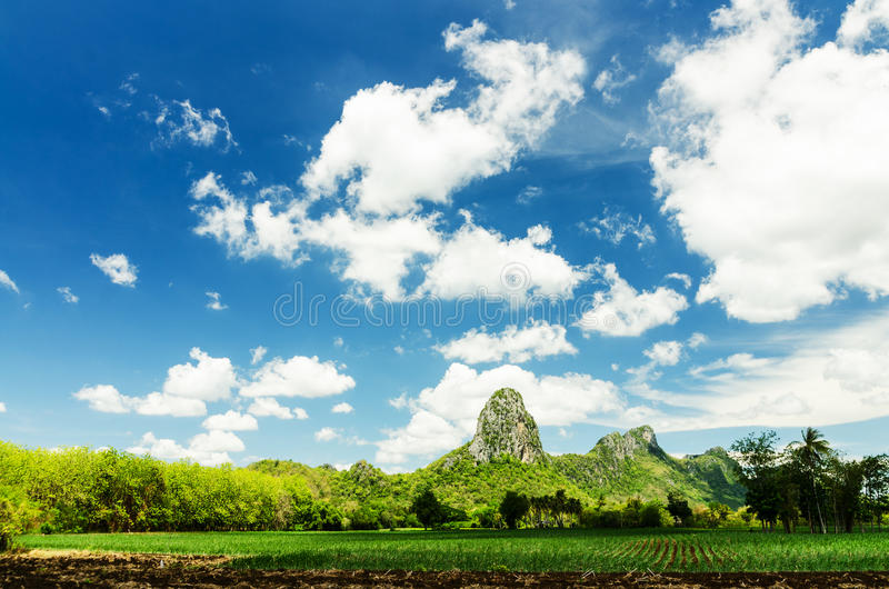 Mountain and cloudy blue sky stock photo