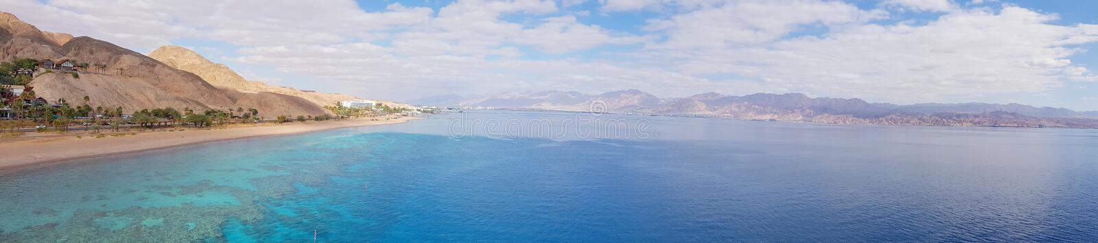 Mountain and coral reef in the Red sea, Israel, Eilat. Panoramic landscape view stock images