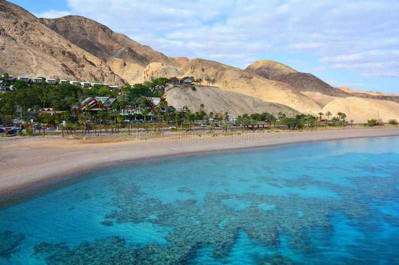 Mountain and coral reef in the Red sea, Israel, Eilat. Panoramic landscape view. Panoramic landscape view of mountains and coral reef in the Red sea, Israel stock images