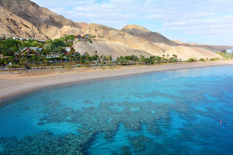 Mountain and coral reef in the Red sea, Israel, Eilat. Panoramic landscape view. Panoramic landscape view of mountains and coral reef in the Red sea, Israel stock photos
