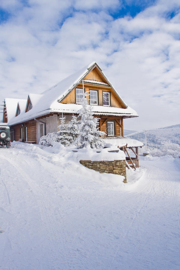 Mountain cottage in winter royalty free stock image